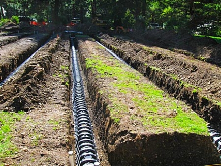 Pressurized drainfield for commercial system using infiltrator chambers